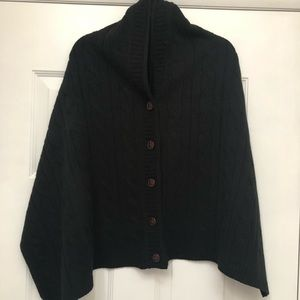 Black cable knit poncho with leather look buttons